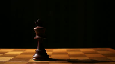 stock-footage-king-chess-piece-on-board-passing-time