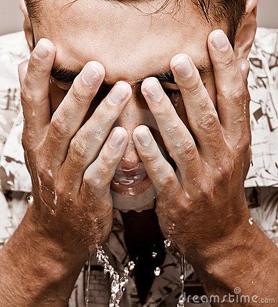 young-man-washing-his-face-thumb13573537